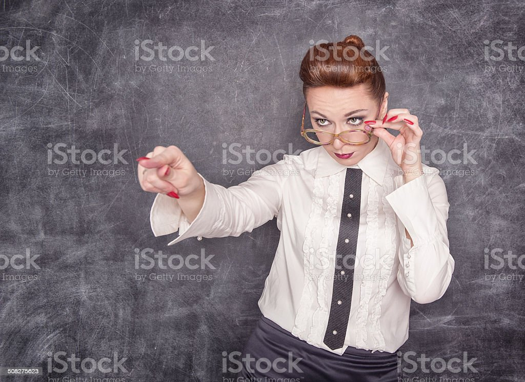 Strict teacher showing on someone by finger stock photo