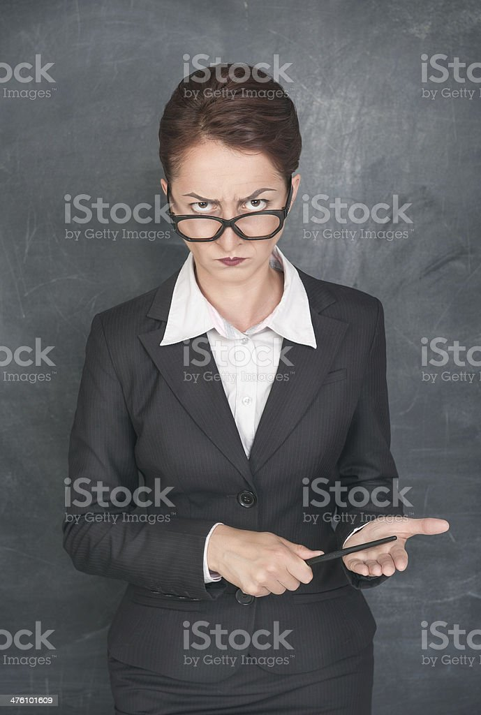 Strict teacher with pointer royalty-free stock photo