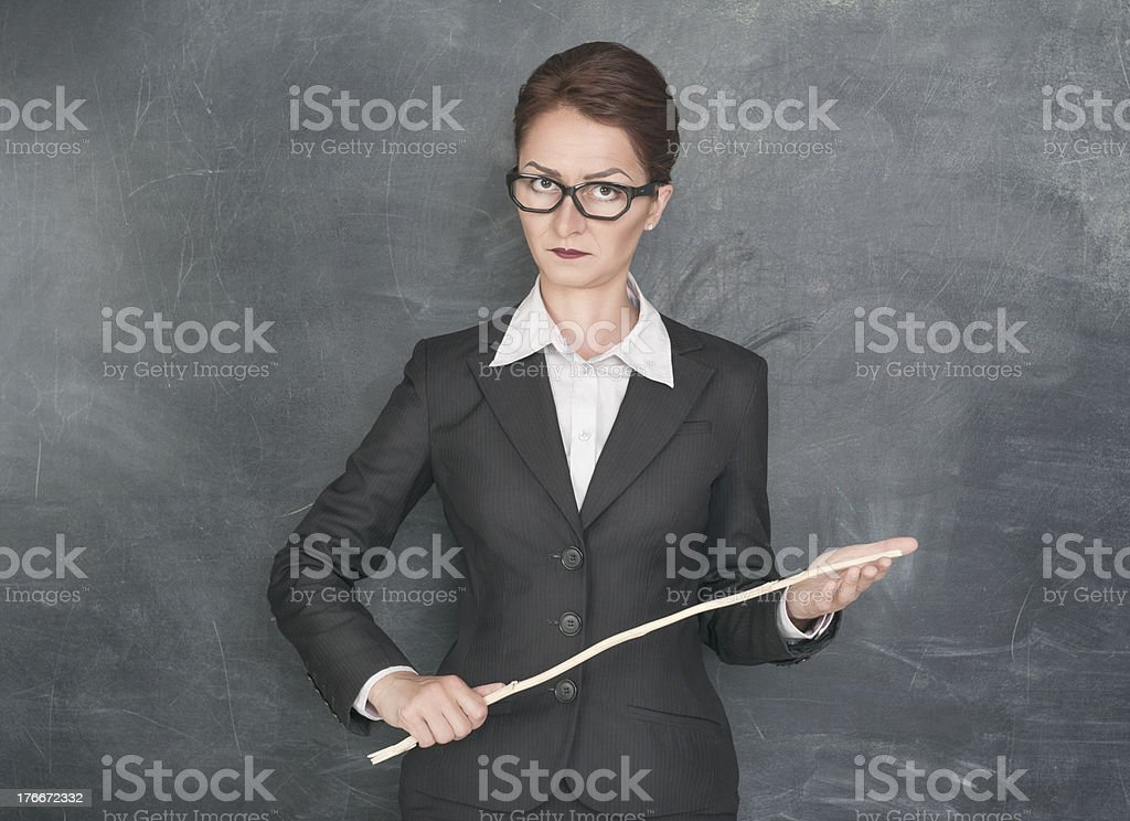 Strict teacher with wooden stick royalty-free stock photo