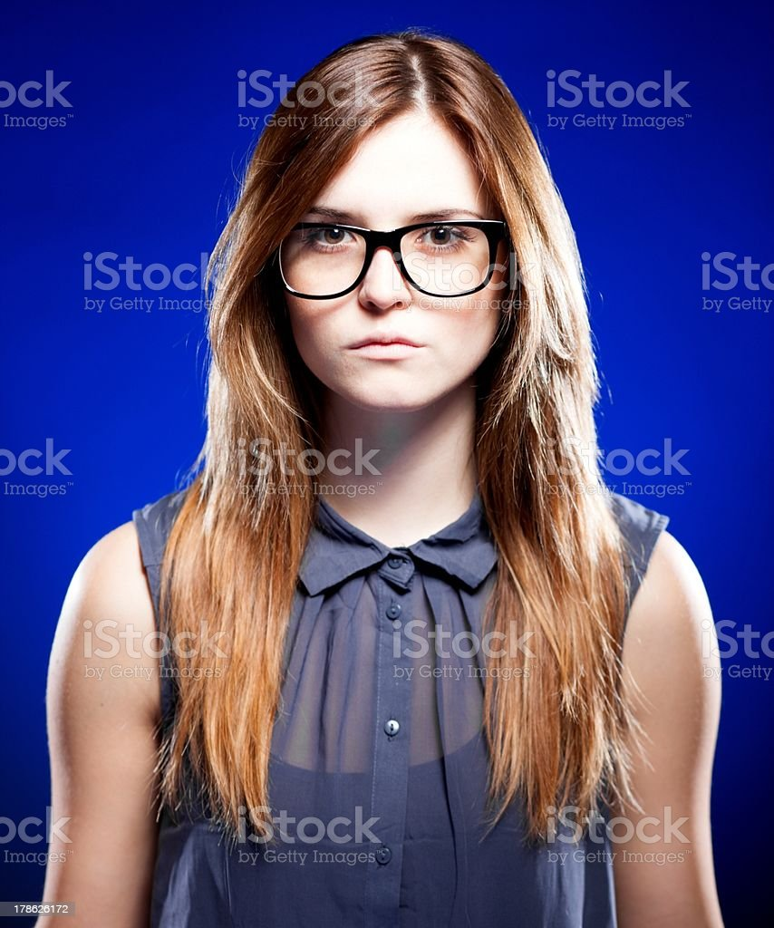 Strict young woman with nerd glasses stock photo