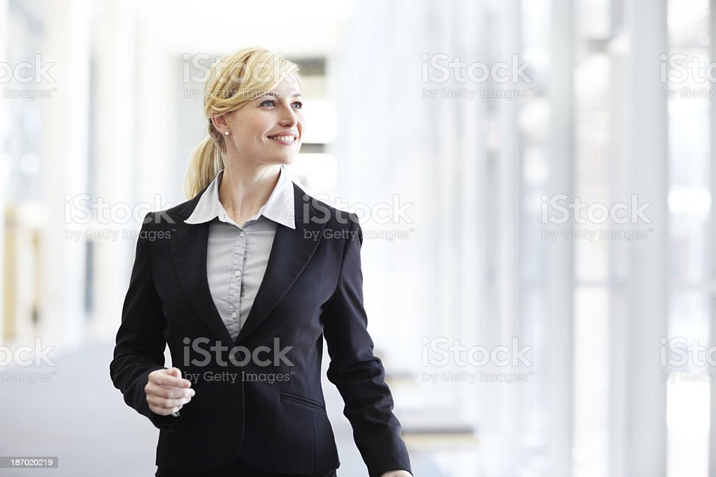 Striding down the corridors of success stock photo