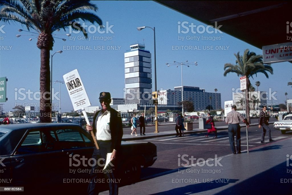 Striker in front of the airport entrance in Los Angeles, 1968 stock photo