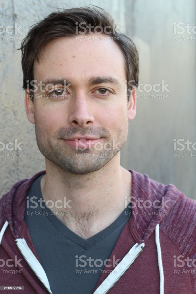 Striking man with neutral expression close up stock photo