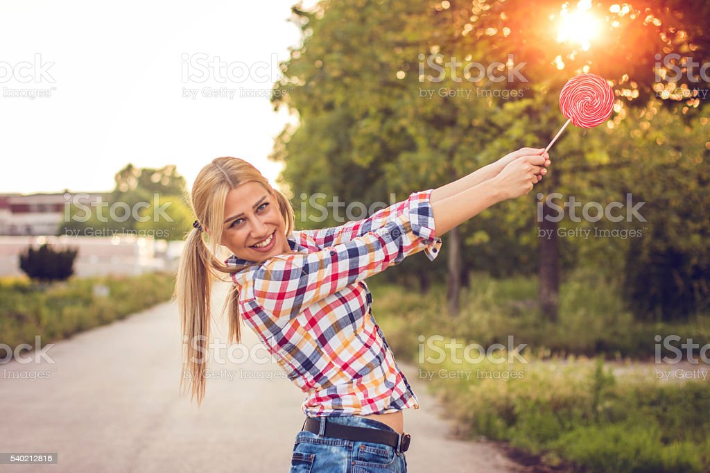 Striking sun with candy stock photo
