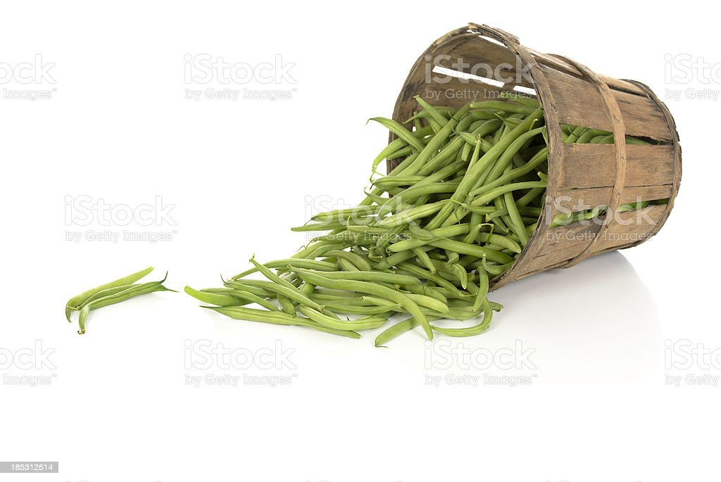 String Beans in a Tipped Rustic Basket stock photo