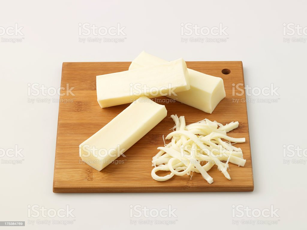 String Cheese On Chopping Board stock photo
