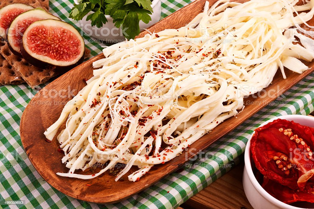 String Cheese On Chopping Board royalty-free stock photo