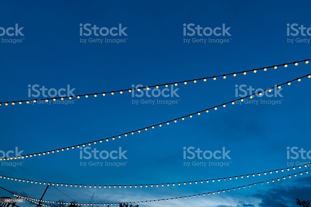 string light bulb and blue sky background stock photo