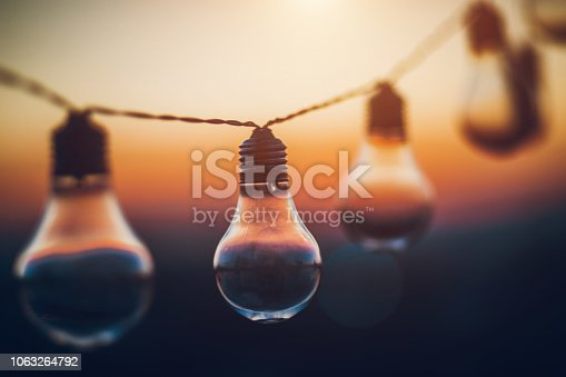 Close-up of string light at sunset