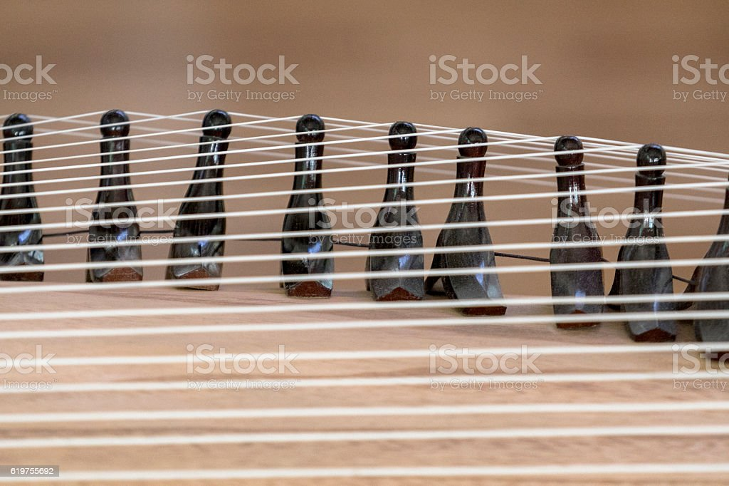 string of ancient zither stock photo