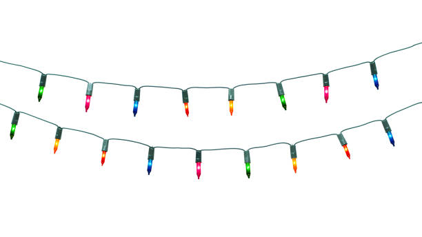 string of christmas lights isolated on white background with clipping path - christmas lights zdjęcia i obrazy z banku zdjęć