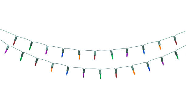 string of christmas lights isolated on white background with clipping path - string stock photos and pictures