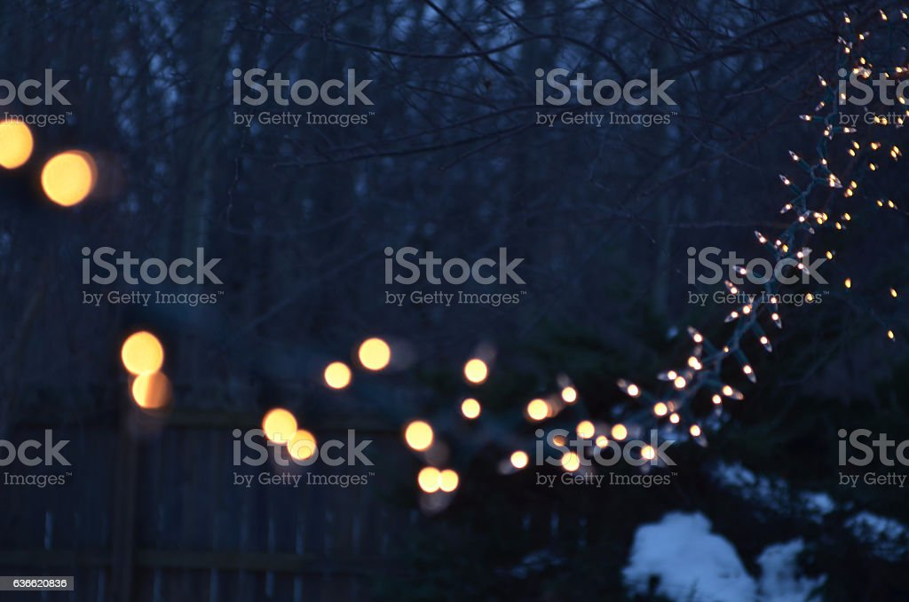 string of lights at night outdoors diminishing prespective stock photo