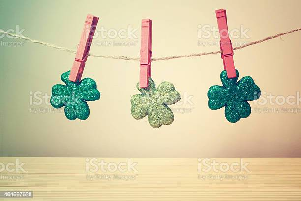 String of twine holding up clovers with red clothes pins picture id464667628?b=1&k=6&m=464667628&s=612x612&h=ywz yy3s1fn n6xhiqh0o5qodgi wdjak1madigpomk=