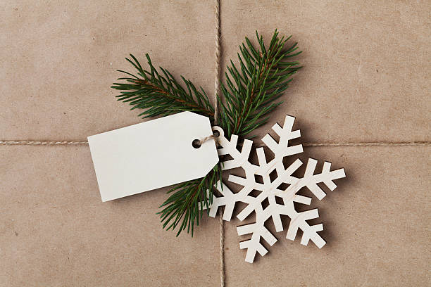 string tied iwith tag, fir tree and wooden snowflake - sisal stock pictures, royalty-free photos & images