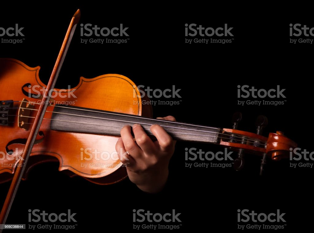 Stringed musical instrument, violin in performer's hands, isolated on black stock photo