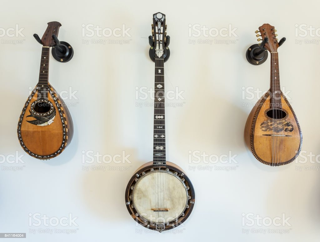 Stringed musical instruments on wall. stock photo