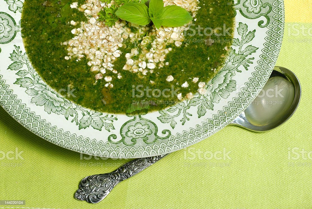 Stringing nettle soup stock photo