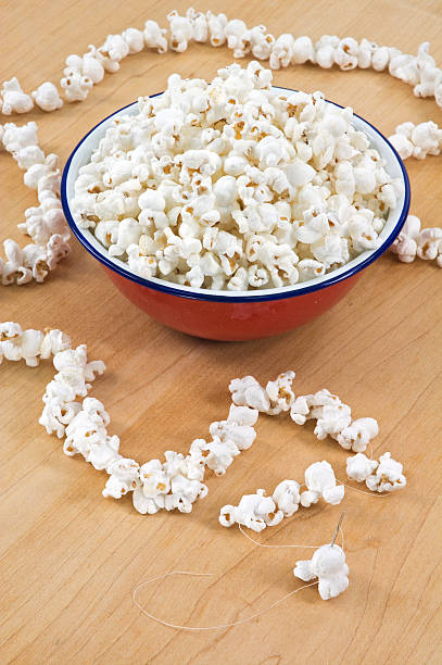 Stringing Popcorn from Above stock photo