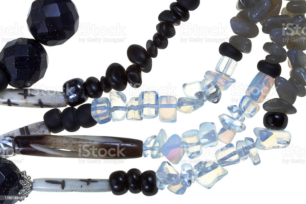 strings of transparent , black stone and bone bugles stock photo