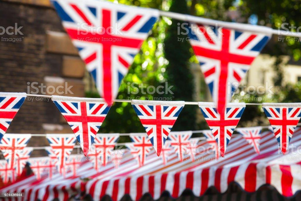 Strings of Union Jack bunts festive decoration in London England UK stock photo