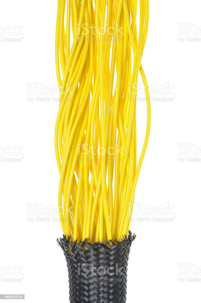 Strings of yellow electrical wires in a protection tube stock photo