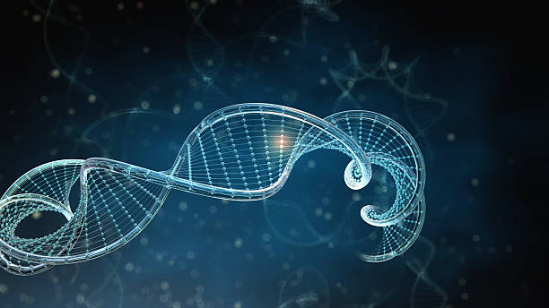 DNA Strings on dark background stock photo