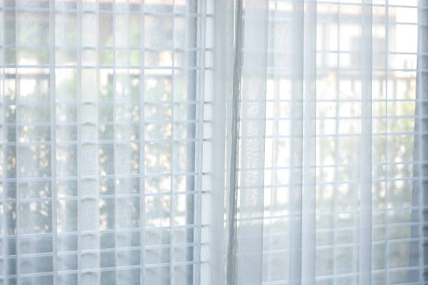 Strip of white curtain,soft focus white background stock photo