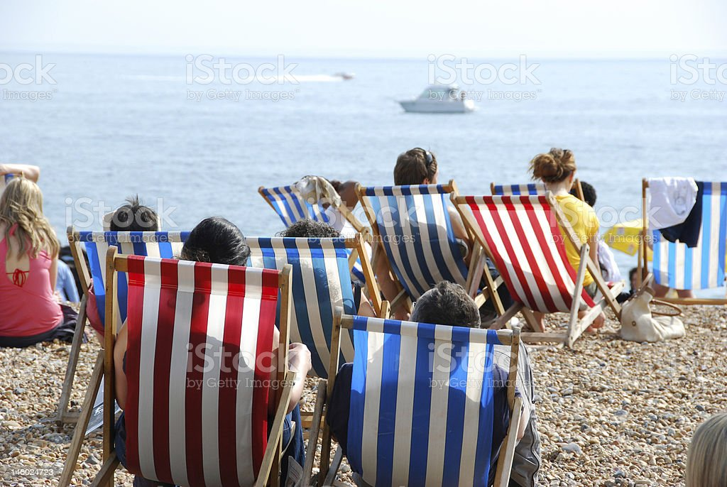 stripe deck chairs at the beach stock photo
