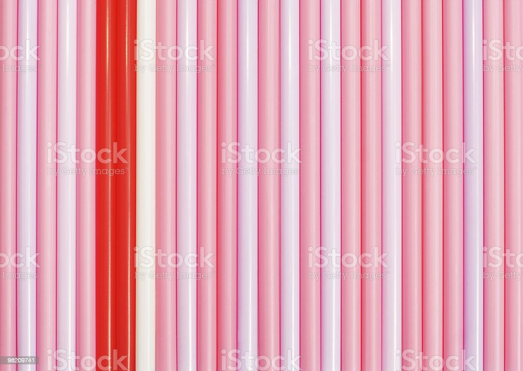 Striped background of pink drinking straws royalty-free stock photo