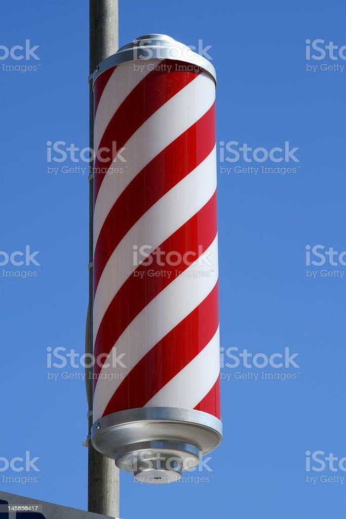 striped barbers pole stock photo