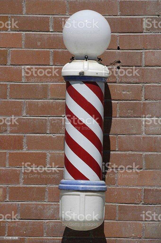 Striped barbershop pole stock photo