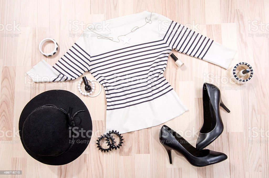 Striped blouse with accessories arranged on the floor. stock photo