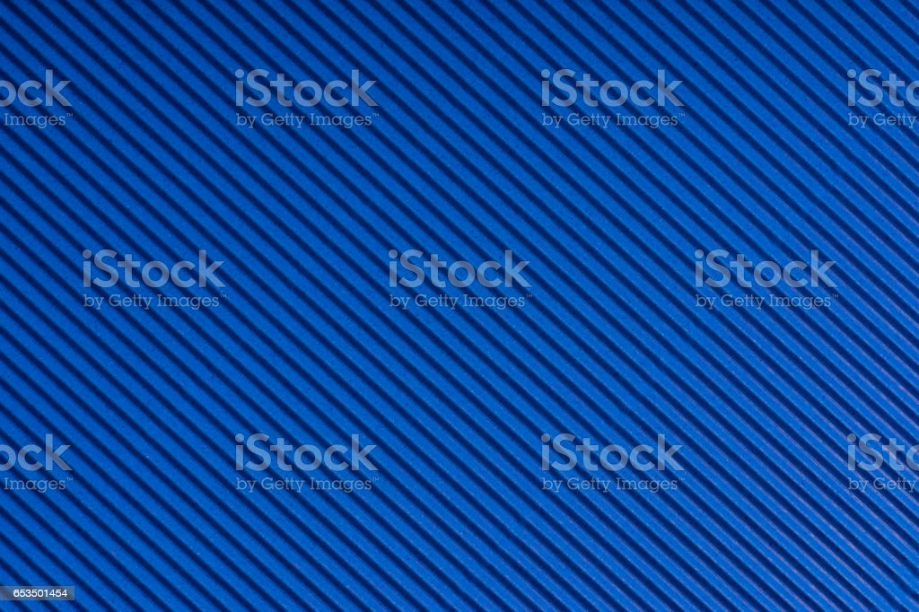 Striped blue embossed paper. Colored paper. Livid texture background stock photo