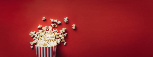 striped box with popcorn - film industry stock pictures, royalty-free photos & images