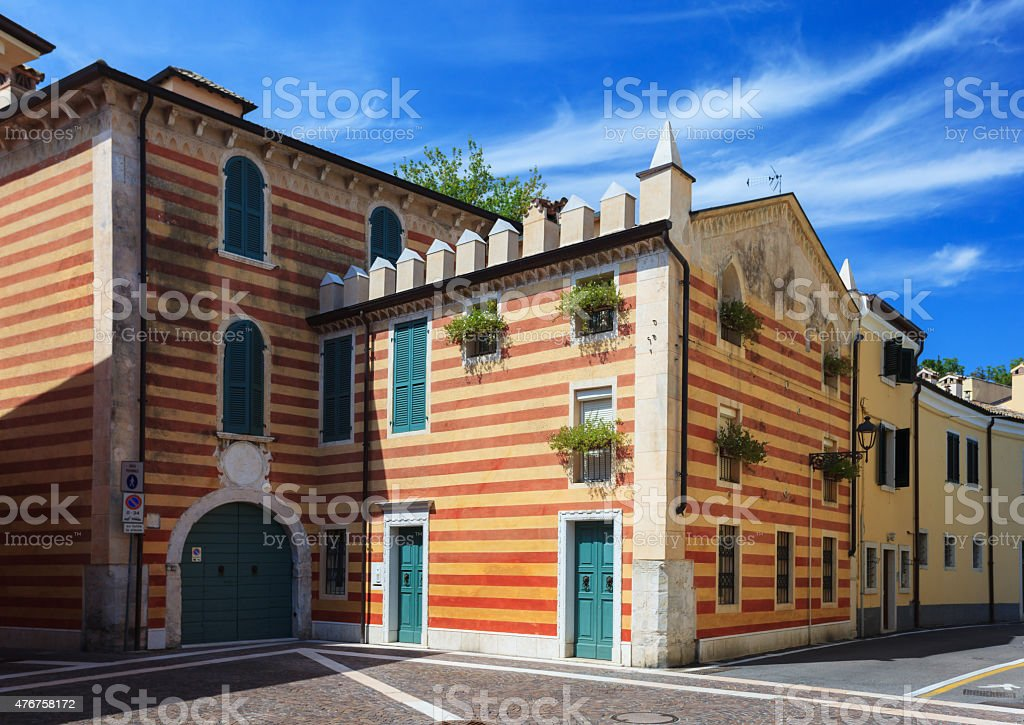 Striped building in Bardolino stock photo