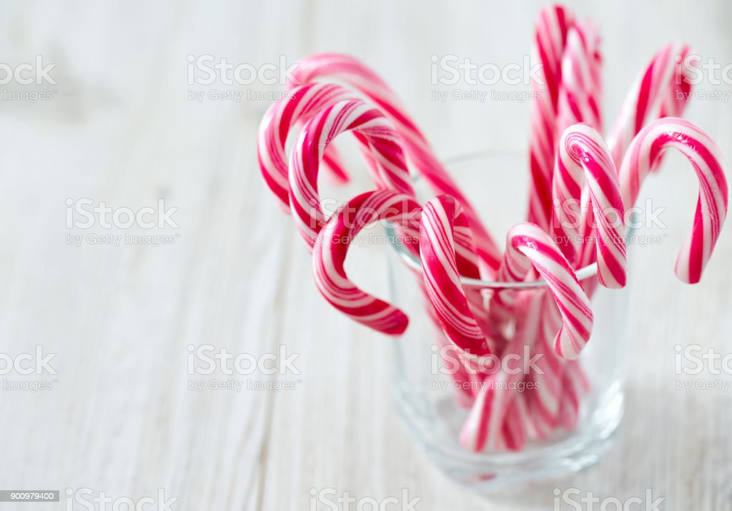 Christmas Candies.Striped Christmas Candies On Wooden Surface Stock Photo Download Image Now