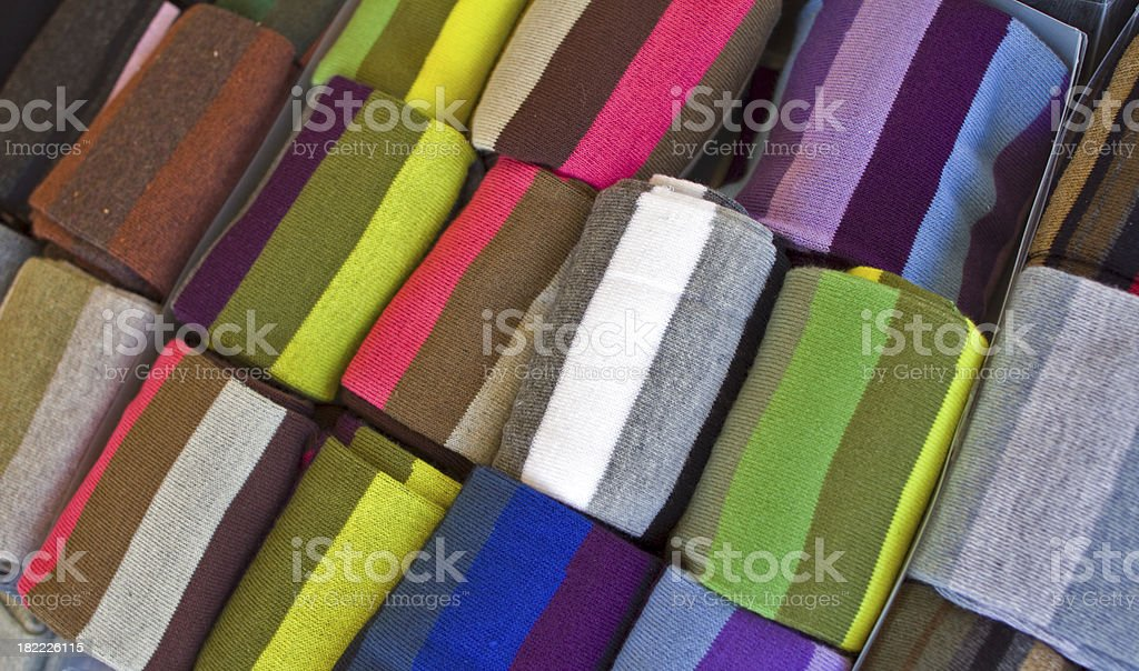 Striped colored socks on a stall at the street market royalty-free stock photo