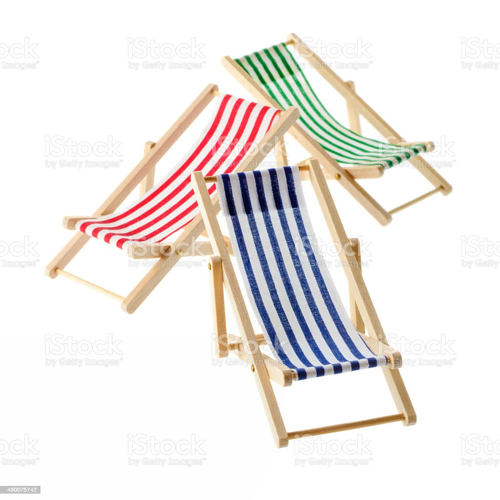 Striped deck chairs royalty-free stock photo