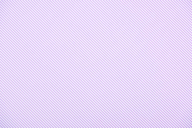 striped diagonal purple and white pattern texture - striato foto e immagini stock