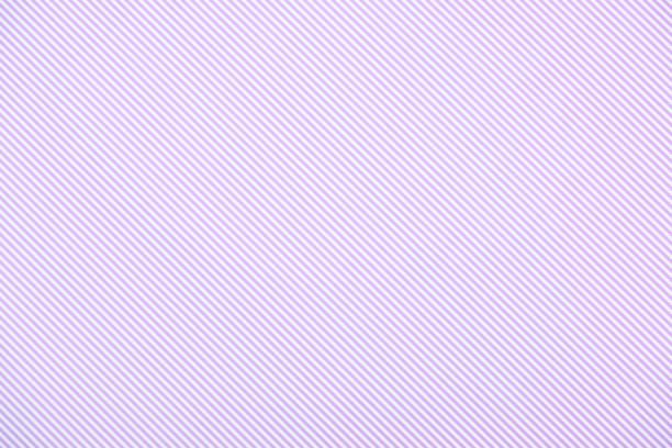 Striped diagonal purple and white pattern texture stock photo