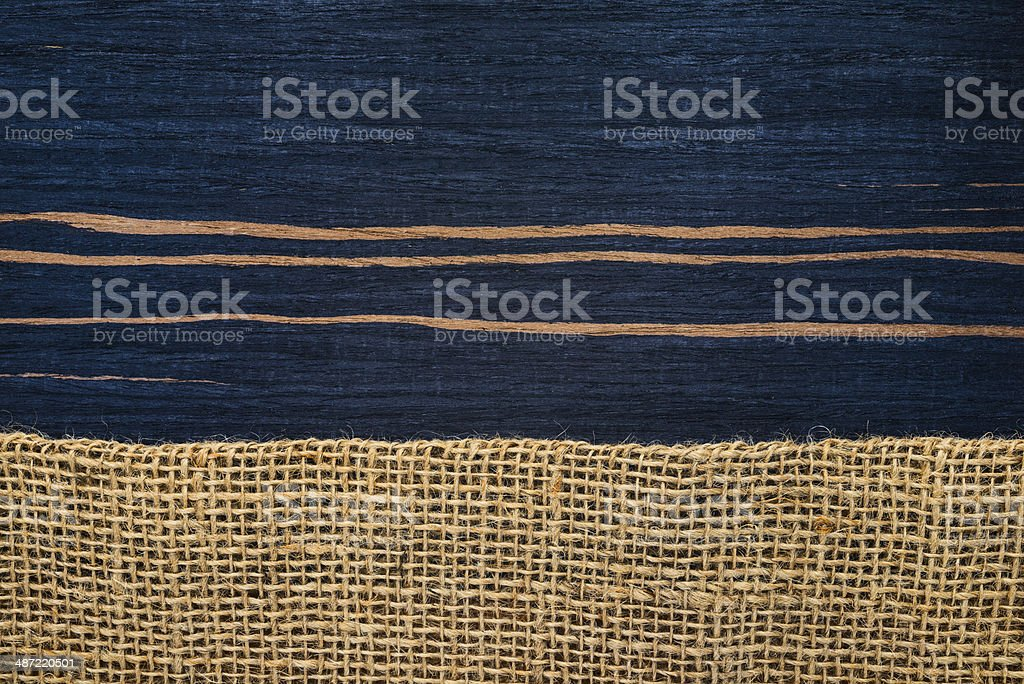 striped ebony wood texture with hessian , rural style stock photo