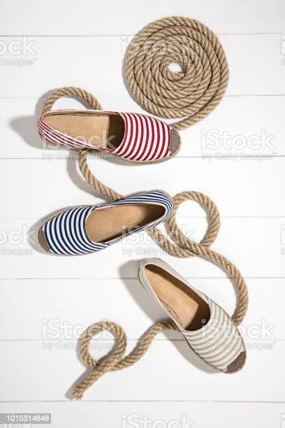 Striped espadrilles isolated on wooden background picture id1015314646?b=1&k=6&m=1015314646&s=612x612&h=ti lolc9ov f1ruv8epcgvyciyzmsxcpkytpgai xku=