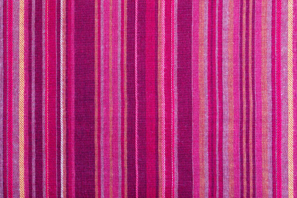striped fabric texture with multiple warm colors (purple, purple, magenta, pink, red, maroon, orange, yellow). close-up of the tissue. ethnic aspect - magenta stock pictures, royalty-free photos & images