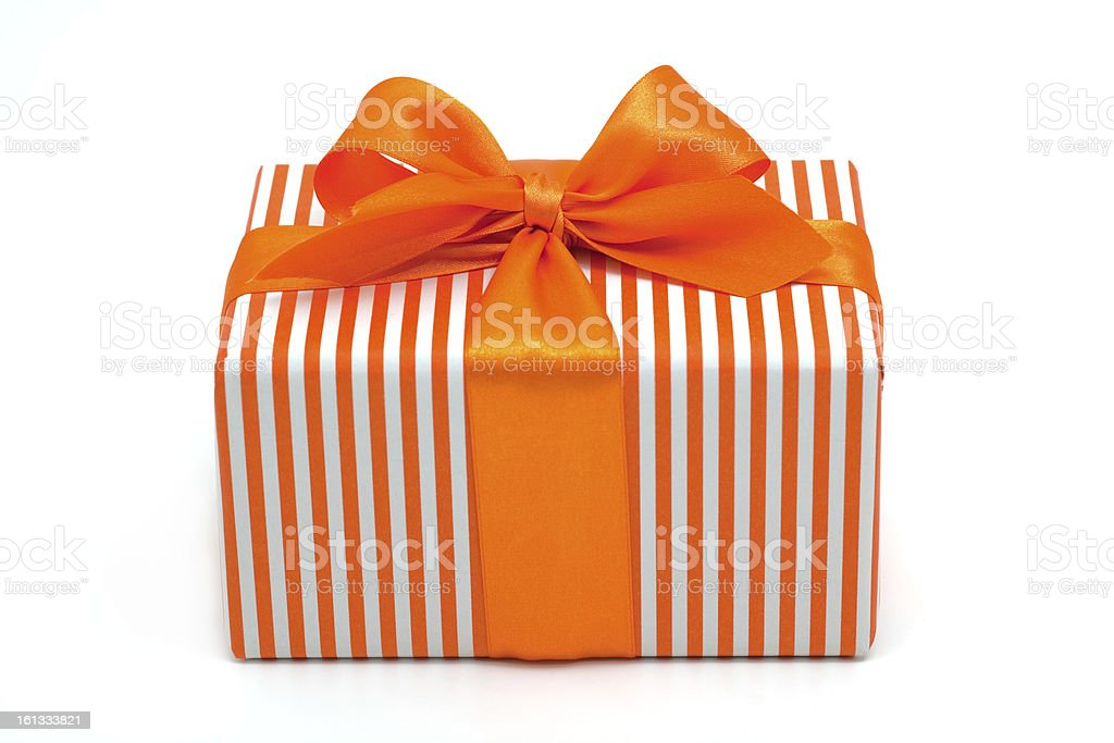 striped gift box with orange ribbon stock photo
