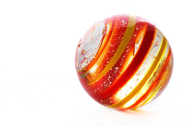 striped glass marble on white stock photo