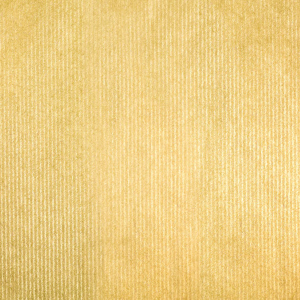 striped golden craft paper texture background stock photo