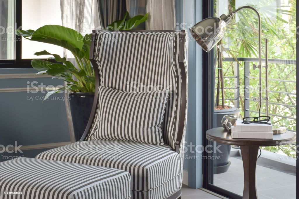 Picture of: Striped High Back Easy Chair With Brass Table Lamp In The Living Room Stock Photo Download Image Now Istock