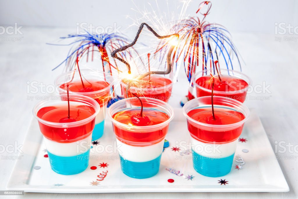 Striped jelly shots with firecracker star stock photo