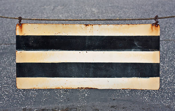 Striped Metal Caution Sign stock photo